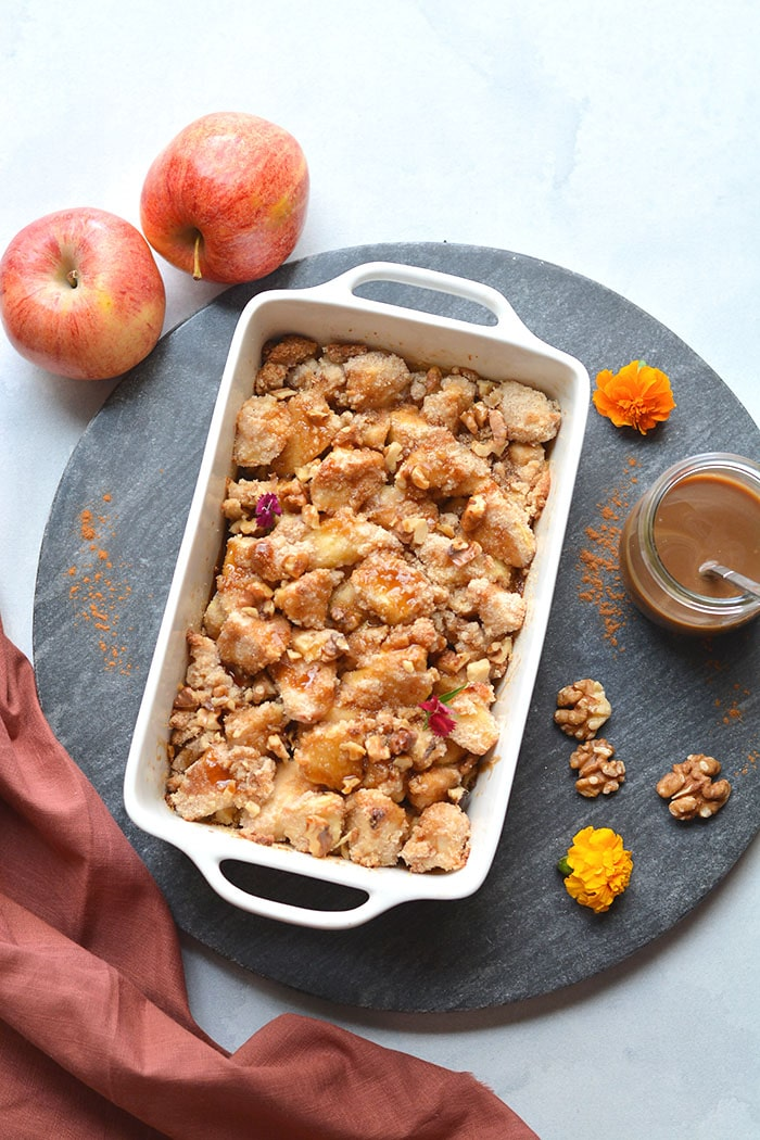 Gluten Free Apple Crisp made with almond flour, cinnamon and lower in sugar. An easy apple crisp that's better balanced in nutrition and dairy free. A healthy dessert recipe that everyone goes crazy for! Gluten Free + Low Calorie + Paleo