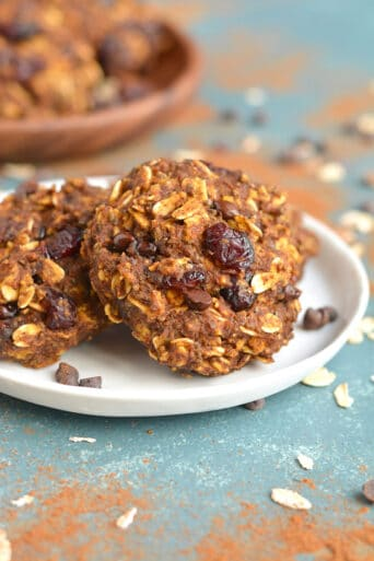 A soft and chewy dairy free oatmeal cookie, loaded with pumpkin and cranberry. Theses Pumpkin Oatmeal Cranberry Cookies are a funwinter breakfast treat.