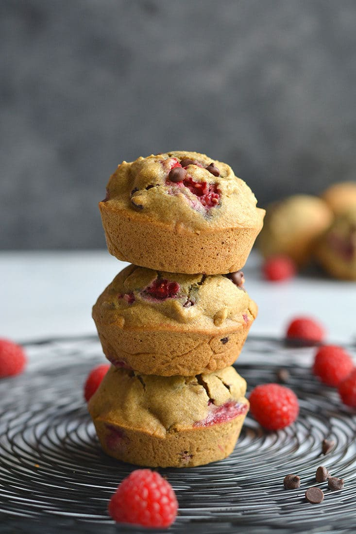 These Skinny Raspberry Chocolate Chip Muffins are easy to make for a healthy breakfast or snack! A gluten free and low calorie muffin recipe made from real food ingredients. With bursts of sweet raspberry and chocolate in every bite, this muffin is so delicious you won't believe it's good for you. Gluten Free + Low Calorie