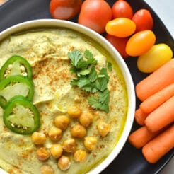 Spicy Cilantro Jalapeño Hummus! Made with fresh ingredients and a kick of spice. This homemade hummus is sure to brighten your plate! Perfect for dipping or using as a marinade. Gluten Free + Vegan + Gluten Free