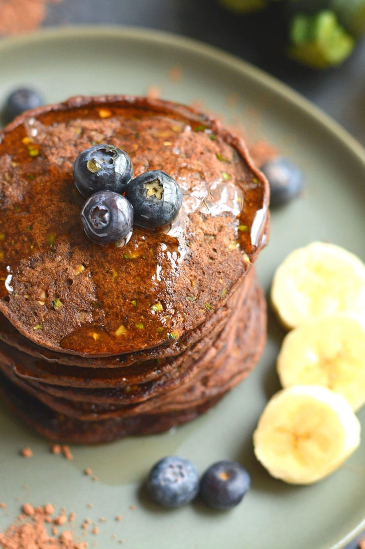 Zucchini Cocoa Pancakes are vegan, gluten free friendly and low in calories! Made with simple wholesome, real food ingredients and oh so tasty! These pancakes are a sneaky way to add more healthy foods to your diet in a chocolaty way. Vegan + Gluten Free + Low Calorie