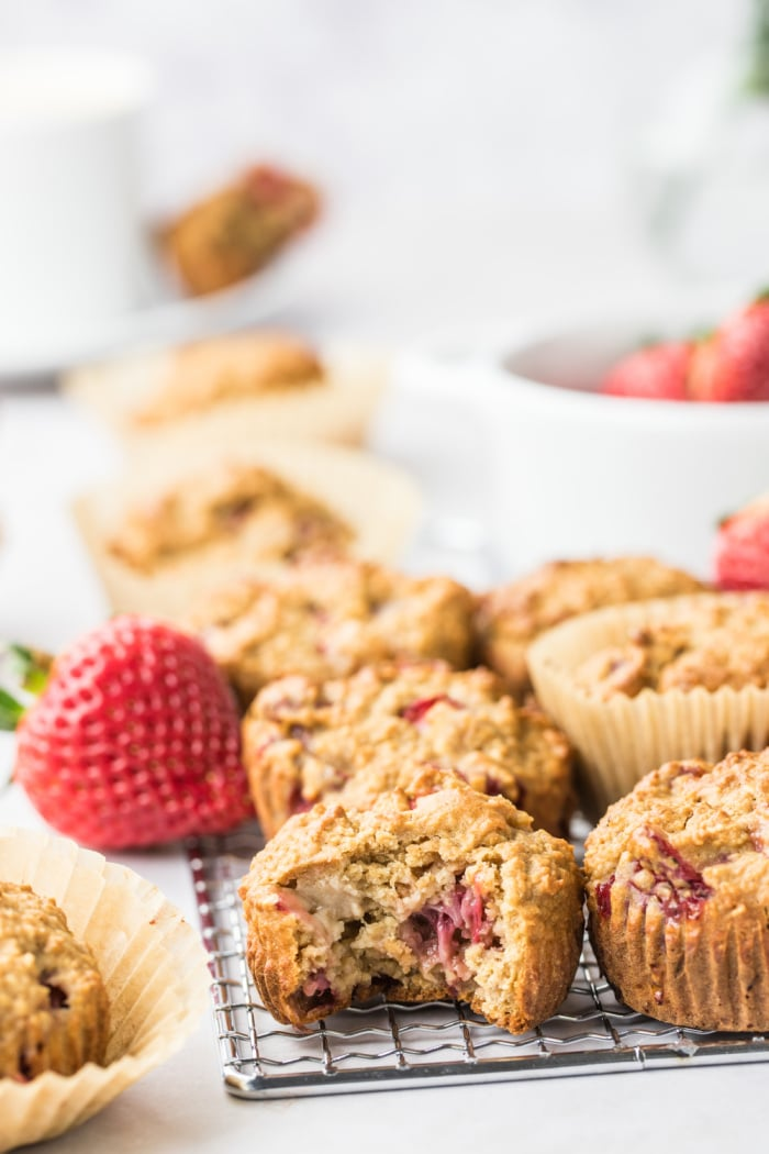 Strawberry Greek Yogurt Muffins! Bursting with strawberries and creamy greek yogurt, these easy to make muffins make a delicious low calorie breakfast or snack for just 84 calories. Quick to make and gluten free too!