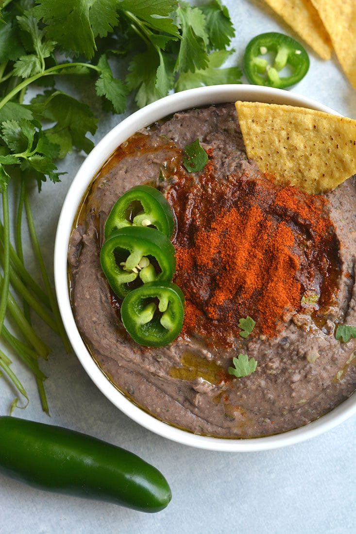 Spicy Black Bean Hummus Without Tahini lightened up by omitting the traditional ingredient without sacrificing taste. Pair with veggies & crackers for a healthy snack or spread on sandwich for extra protein & spice! Gluten Free + Vegan + Low Calorie