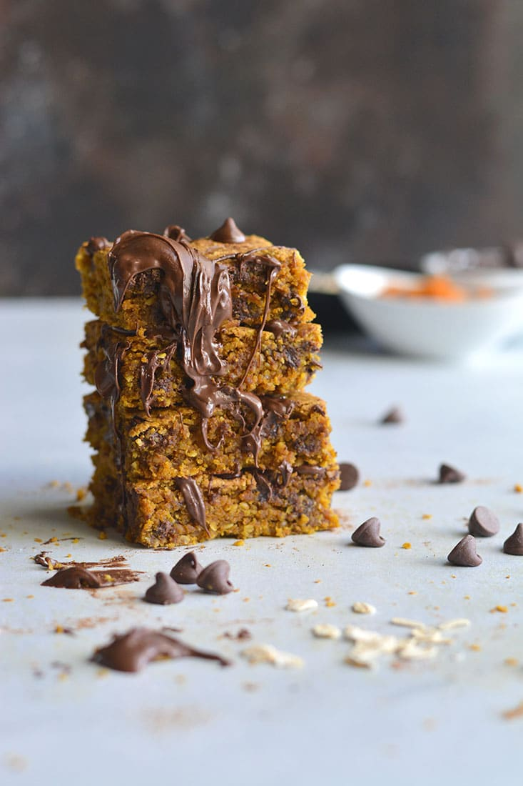 Pumpkin Chocolate Chip Cookie Bars are made with healthier baking ingredients for a better for you baked treat! Gluten free, lower in sugar and absolutely delicious! Vegan + Low Calorie + Gluten Free