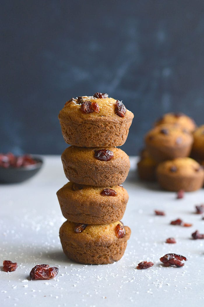 Delicious Coconut Cranberry Muffins made with Greek yogurt, coconut and oat flour are lightly sweetened. A healthier gluten free breakfast or snack on the go. Gluten Free + Low Calorie