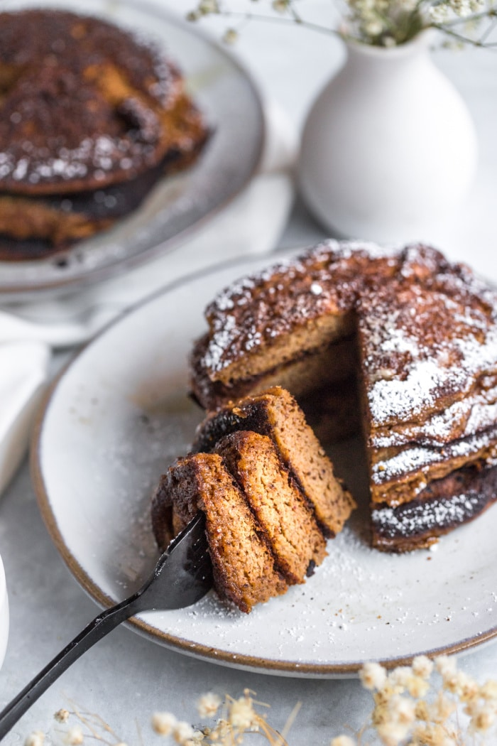 Pumpkin Coconut Pancakes made with coconut flour, nut butter, pumpkin and bananas! These thick, cake-like pancakes are perfect for a hearty fall breakfast. The BEST coconut flour pumpkin pancakes ever!