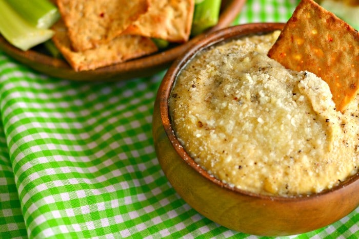 This roasted Garlic Parmesan Hummus is silky smooth, the creamiest hummus you will ever have! Layered with nutty flavors and loaded with garlic and pepper this dip has a flavorful kick. Your every day hummus jazzed up that will leave you begging for more!