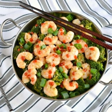 Shrimp & Broccoli Stir Fry is a quick, easy and healthy dinner you can make in under 20 minutes that's only 241 calories. A mouthwatering, one skillet meal great for a busy day! Gluten Free + Low Calorie