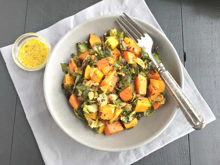 Brussels Sprouts Sweet Potato Salad is a warm and hearty salad. Made with roasted butternut squash, sweet potatoes and shredded brussels sprouts this nutrition packed salad is full of sweet and savory flavors!