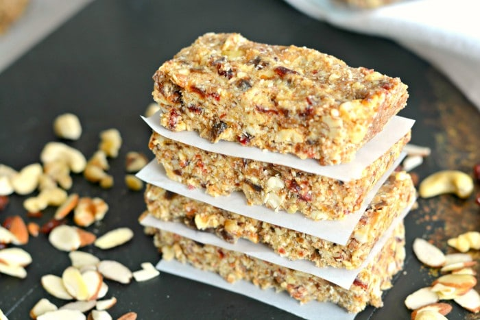 Grain Free Date Nut Bars are a no bake snack made with mixed nuts, shredded coconut and cashew butter that are oil and sugar free. They're gluten free, grain free, Paleo and vegan. A creamy and nutritious snack!