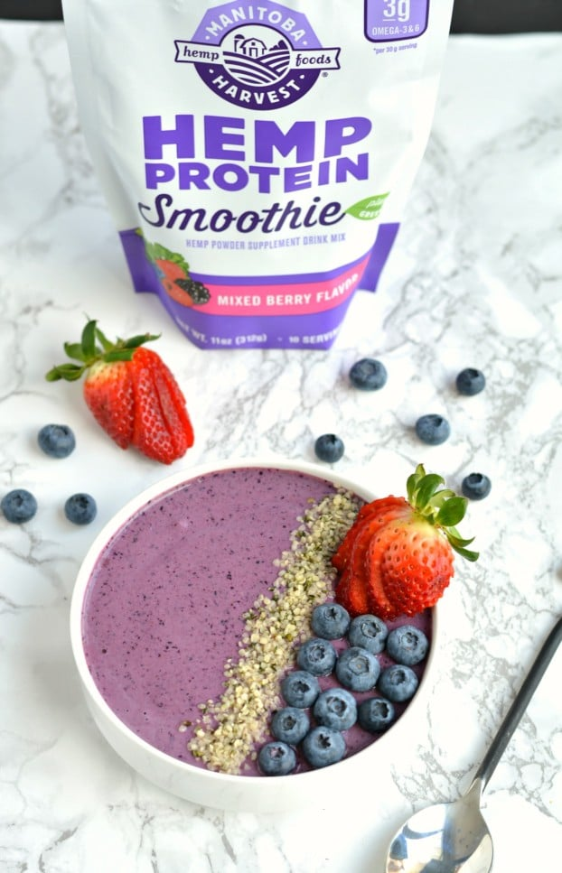 Wake up to a creamy Berry Hemp Smoothie Bowl laced with sweet berries, Greek yogurt and hemp protein powder! This gluten free smoothie bowl is a nutritious and refreshing meal or snack for warm weather and great for post workout recovery!