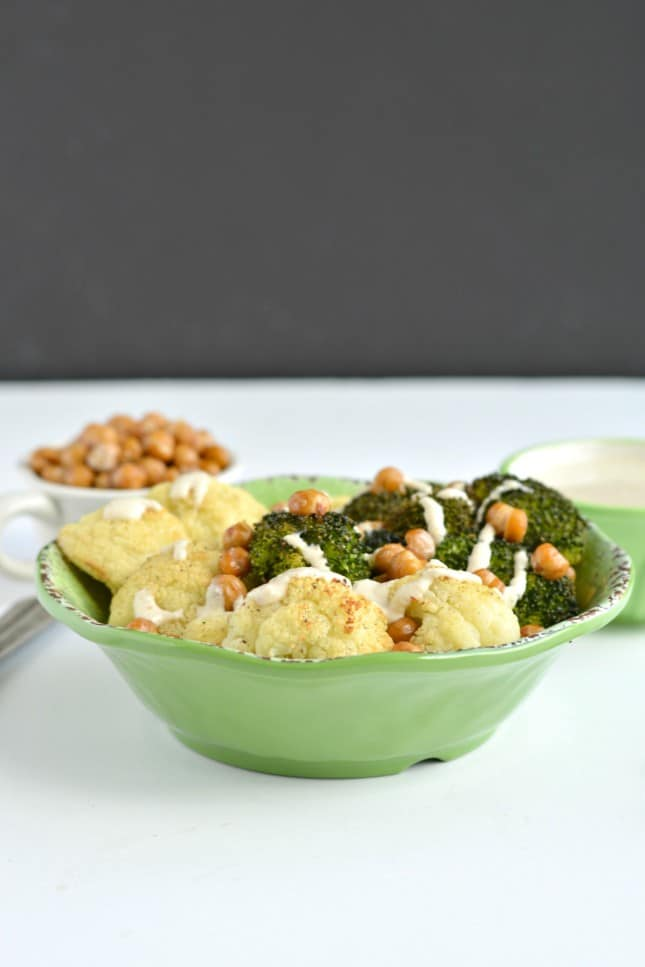 Broccoli Cauliflower Chickpea Bowl with a rich and creamy Tahini Lemon Sauce! This simple roasted vegetable and chickpea bowl is gluten free, Vegan and low calorie. A super EASY and satisfying meal guaranteed to keep you full for hours. Great for lunch, dinner or snacking!