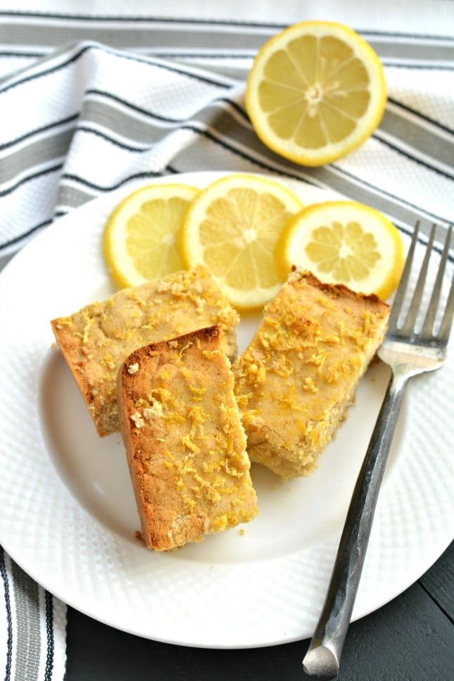 A luscious Paleo Coconut Lemon Cake that's thick and bursting with lemon! Made with coconut flour and topped with crispy baked lemon zest, this cake makes an excellent low-carb, gluten-free, calorie friendly snack!