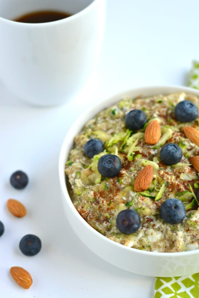 Zucchini Oatless Oatmeal is a Paleo twist on a classic bowl of morning oatmeal. Made with eggs, almond milk, zucchini, applesauce, flaxseed and cinnamon, this simple bowl of goodness is packed with protein and fiber. A nutritious way to stay full all morning!