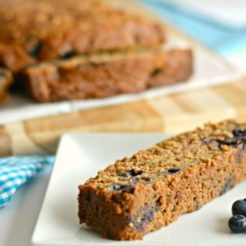Gluten Free Zucchini Blueberry Bread! This hidden veggie bread is bursting with natural sweetness, loaded with nutrients & fiber. A wonderful anytime bread that even picky eaters will love! Gluten Free + Low Calorie