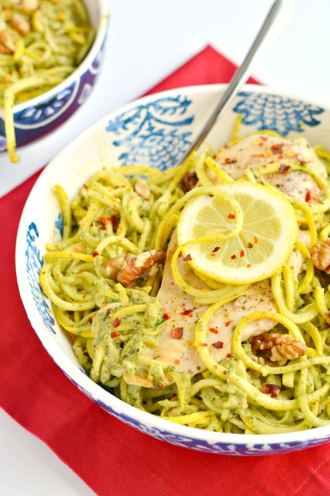 Baked chicken tops spiralized squash with a homemade walnut pesto in this Walnut Pesto Chicken Summer Squash. A simple 30 minute, HEALTHY meal that's Whole 30 compliant, Paleo, Gluten Free and low calorie friendly!