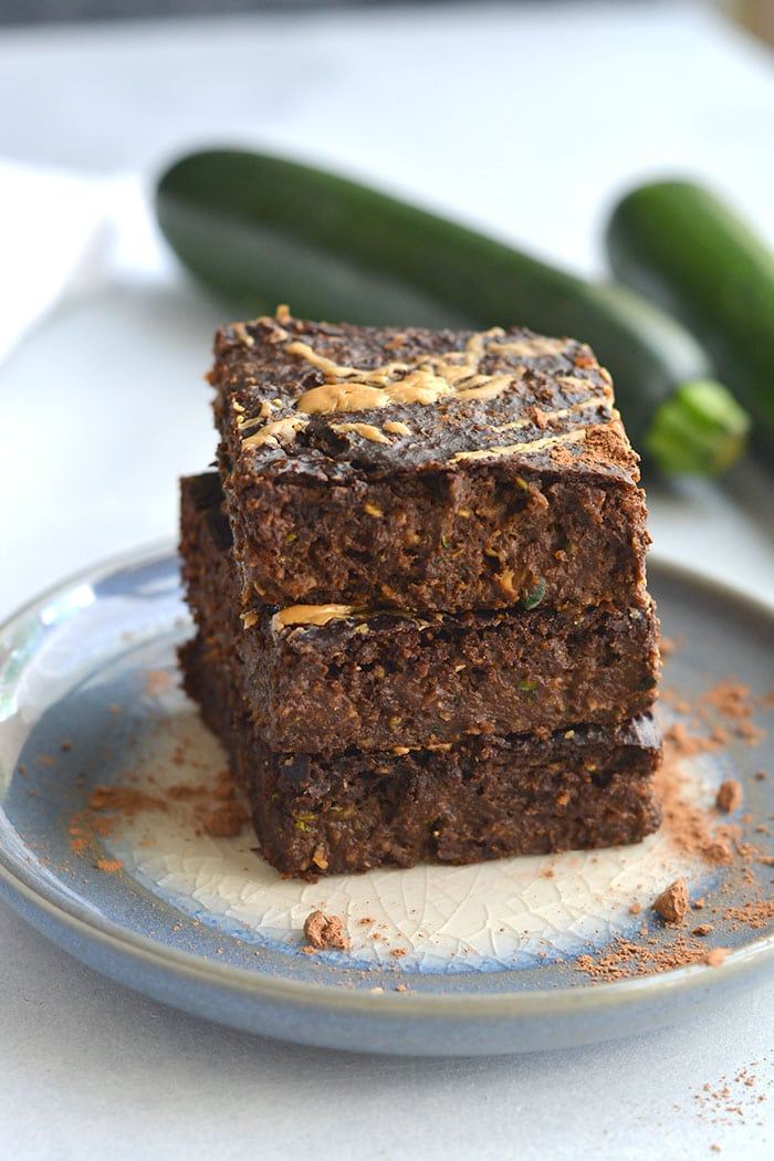 Creamy Zucchini Chocolate Espresso Brownies with an almond butter swirl! Made with almond butter, chocolate, espresso and oats, these brownies are gluten free, vegan and low calorie with a Paleo option too. Luscious chocolate-y brownies that make healthy eating easy! Gluten Free + Low Calorie + Vegan