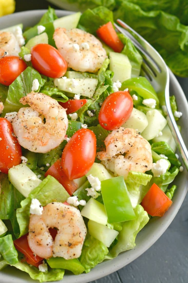 This Greek Shrimp Salad is a light, refreshing and EASY meal. Loaded with a secret blend of spices, freshly chopped vegetables and grilled shrimp, this healthy meal is equally delicious and filling!
