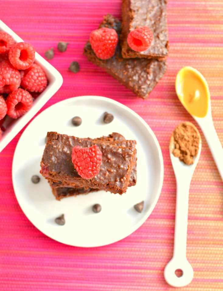 Vegan Chocolate Raspberry Quinoa Brownies made flourless with almond butter, quinoa, cocoa powder and fresh raspberries. These thick, chewy & creamy brownies are guaranteed to be the best brownie of your life!