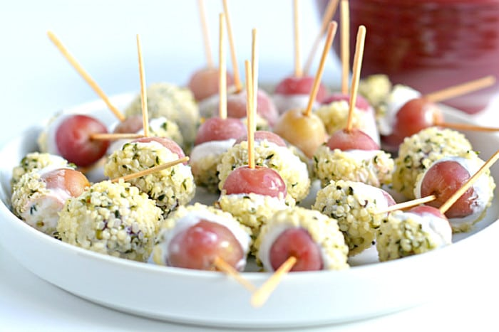 Transform frozen grapes into Greek Yogurt Grape Popsicles dipped in hemp seeds! A sweet & healthy snack, perfect for hot days and always a party favorite!