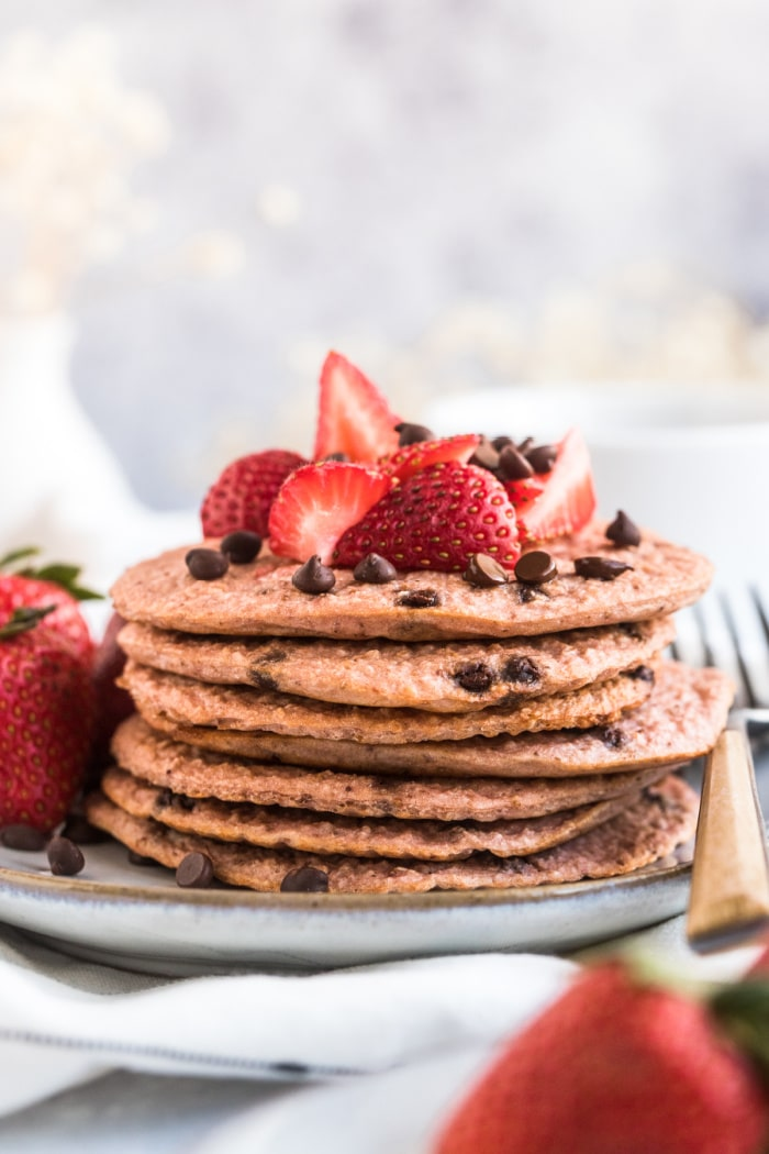 Healthy Strawberry Oat Chocolate Chip Pancakes made low calorie with gluten free oats and Greek yogurt. A healthy strawberry pancake recipe!