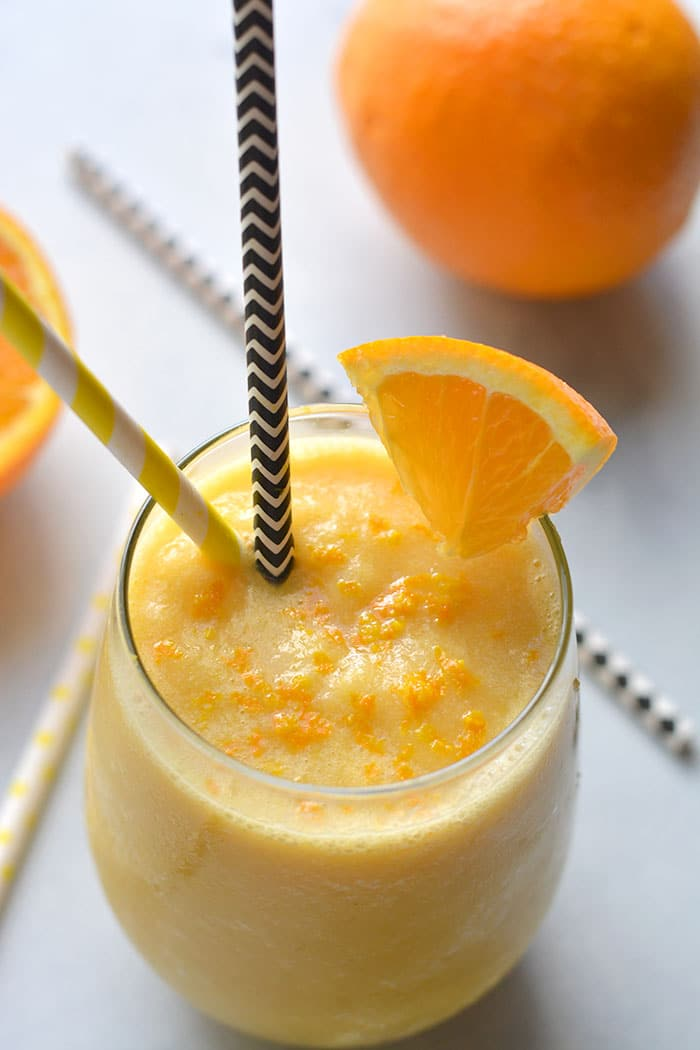 This Healthy Orange Julius Smoothie is made with 5 ingredients in 5 minutes. A refreshing spin on an orange vanilla smoothie that's lighter and waist-friendly! Whole30 + Gluten Free + Low Calorie + Vegan + Paleo