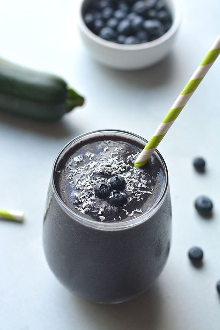 Blueberry Protein Smoothie made with zucchini! High protein, high in Vitamin C and antioxidants. An on the go smoothie, perfect for breakfast and a great way to sneak in vegetables! Gluten Free + Vegan + Paleo option
