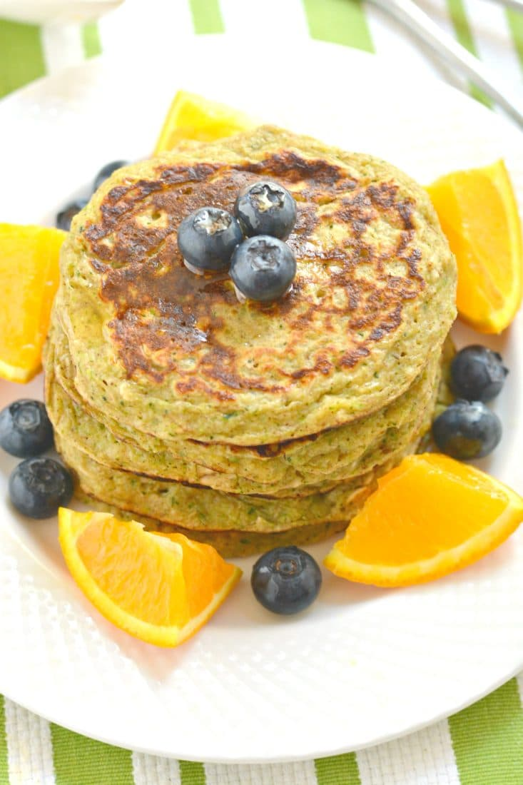 Zucchini Greek Yogurt Pancakes are packed with protein, whole grains and fiber. A mouthwatering stack that's fluffy on the outside & creamy on the inside. A great low calorie breakfast to start your day!