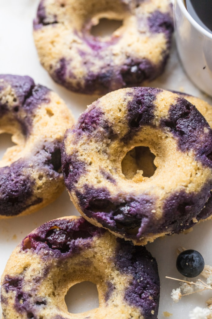 Blueberry Chickpea Donuts are backed for a healthier donut that is low calorie, low in sugar, naturally gluten free and delicious! No one will ever guess these donuts are made with chickpeas!