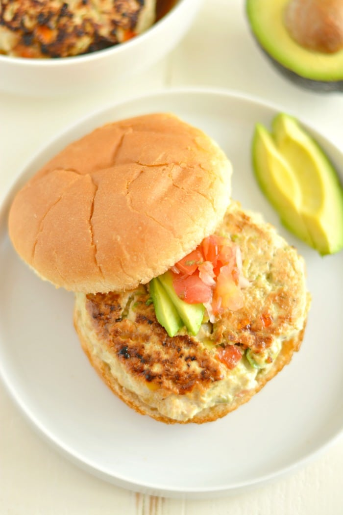 Chicken Guacamole Burgers stuffed with fresh guacamole make a tender, juicy burger bursting with spicy, creamy goodness! Take your traditional burgers up a notch with this EASY low carb dish.