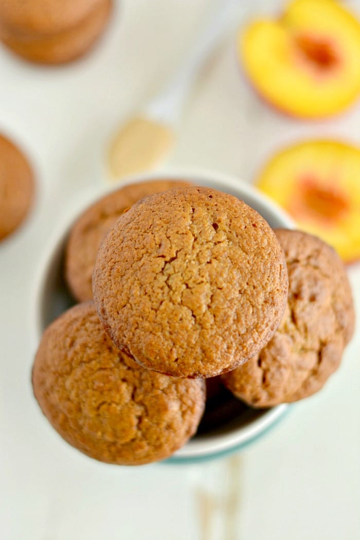 Peach Cashew Muffins made extra creamy with cashew butter. A mildly sweet, healthy muffin that makes a nutritious on the go snack! Gluten free and low calorie!