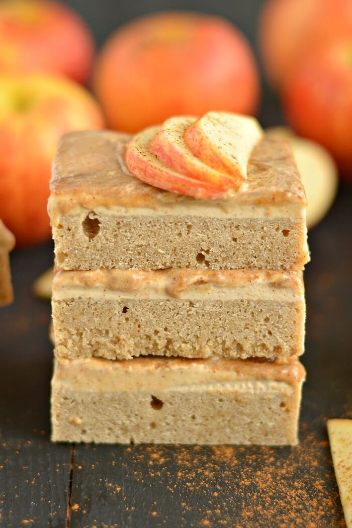 Greek Apple Cinnamon Cheesecake Bars are a lighter version of classic cheesecake. Spiced with fall flavors and made with Greek cream cheese, this healthier dessert is a party favorite! Gluten Free + Low Calorie