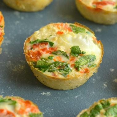 Cauliflower Egg Muffins made with cauliflower rice! With 6 grams of protein &less than 1 gram of carbs, these egg muffins make a nutritiousmake ahead breakfast you can takewith you on-the-go! Paleo + Gluten Free + Low Calorie.