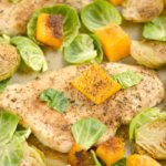 This One Pan Chicken Brussels Sprouts & Butternut Squash is perfectly baked on a single pan for an EASY and filling dinner. A Paleo, Gluten Free & Low Calorie meal that takes 30 minutes, ideal for any weeknight meals or meal prepping!