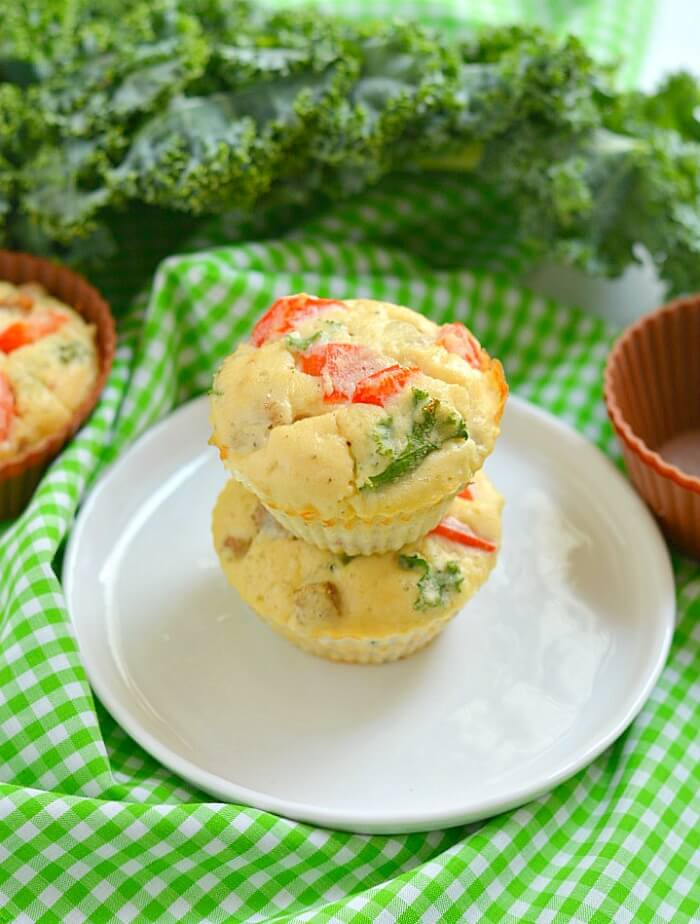Paleo Sausage Kale Coconut Egg Muffins made with coconut flour for a rich, creamy texture. Hearty & filling breakfast muffins that tastes like mini pizzas! Gluten Free + Low Calorie + Paleo