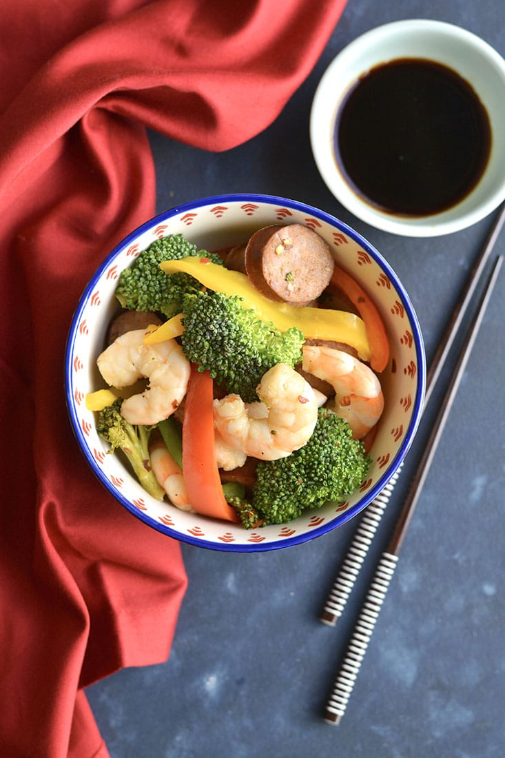 Spicy Shrimp Sausage Stir-Fry! An easy, 30-minute protein packed meal loaded with a rainbow of veggies. A meal you can feel good about feeding your family that tastes great too! Paleo + Gluten Free + Low Calorie!