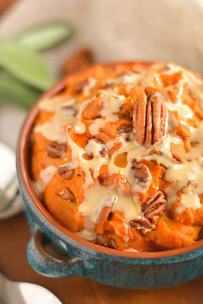 This warm Maple Tahini Butternut Sweet Potato Mash is a healthier version of sweet potato casserole. Lightly sweetened with maple syrup, savory tahini sauce and topped with pecans to make the perfect side dish for fall, winter and holiday gatherings. Gluten Free + Low Calorie + Vegan + Paleo