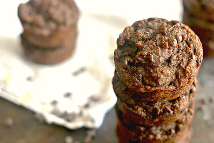Healthy Molasses Pumpkin Chocolate Chip Muffins lightly sweetened with applesauce, brown sugar and molasses. A tasty chocolate treat packed with fall spices and irresistible flavors! Gluten Free + Vegan + Low Calorie