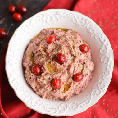 Spice things up with a Cranberry Hummus! This twist on traditional hummus makes a tasty holiday appetizer or winter snack, & guaranteed to add a kick to your plate! Gluten Free + Low Calorie + Vegan