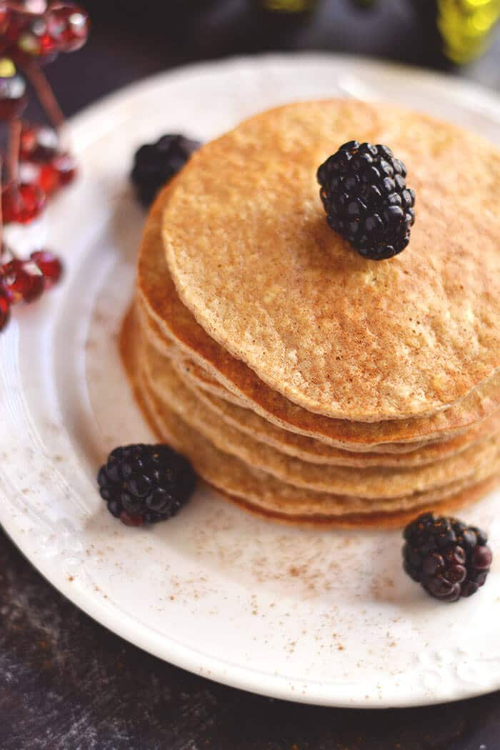 Bursting with winter spices, these Gingerbread Protein Pancakes are cozy, comforting & healthy! A seasonal protein packed breakfast that's easy & delicious! Gluten Free + Low Calorie + Dairy Free