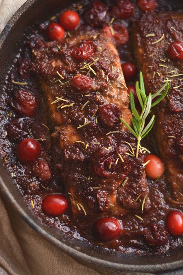 Skillet Cranberry Balsamic Salmon! This ONE skillet roasted balsamic salmon infused with maple syrup & cranberries is a simple 30 minute sweet & pungent dinner. Perfect for holiday & winter dinner menus! Paleo + Gluten Free + Low Calorie!