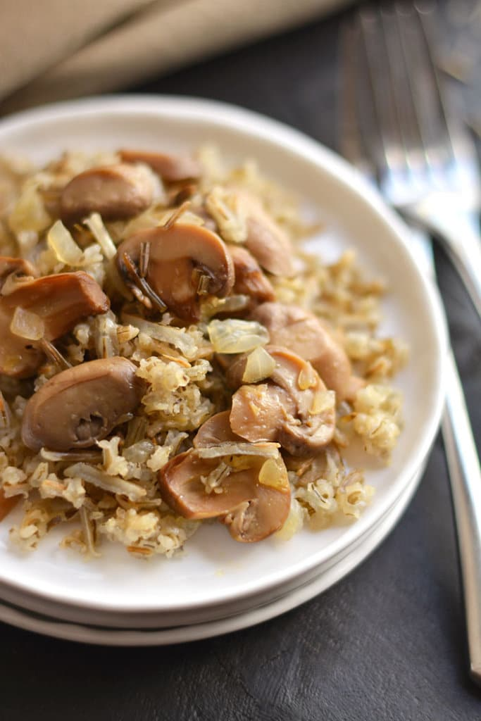 This Classic & Healthy Wild Rice Casserole is made with mushrooms & onions. A hearty vegetarian or side dish that's easy to make & guaranteed to please a crowd. Gluten Free + Low Calorie + Vegan