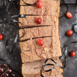 Skinny Cranberry Coconut Bread made low in sugar with healthy, wholesome ingredients. The perfect thick & chewy bread to celebrate the holidays, and makes a great gift! Gluten Free + Low Calorie + Paleo