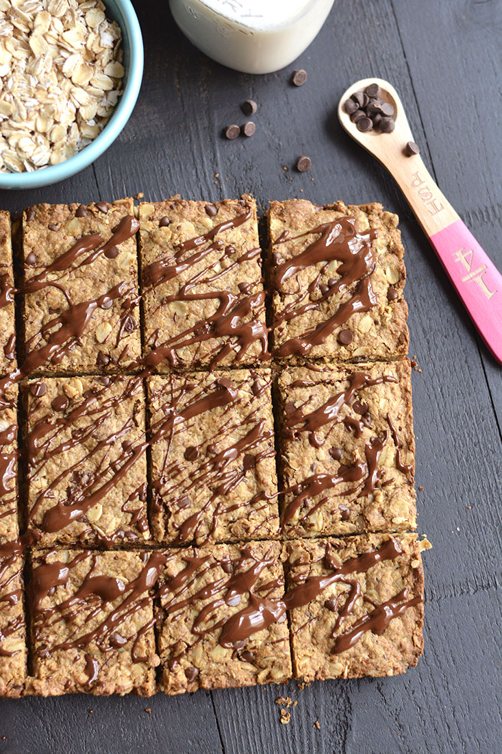 Chocolate Peanut Butter Granola Bars with protein & oats! Loadedwith complex carbs, healthy fat &protein, this homemade granola bar recipe is perfect for healthy breakfast or snack! Gluten Free + Low Calorie + Vegan
