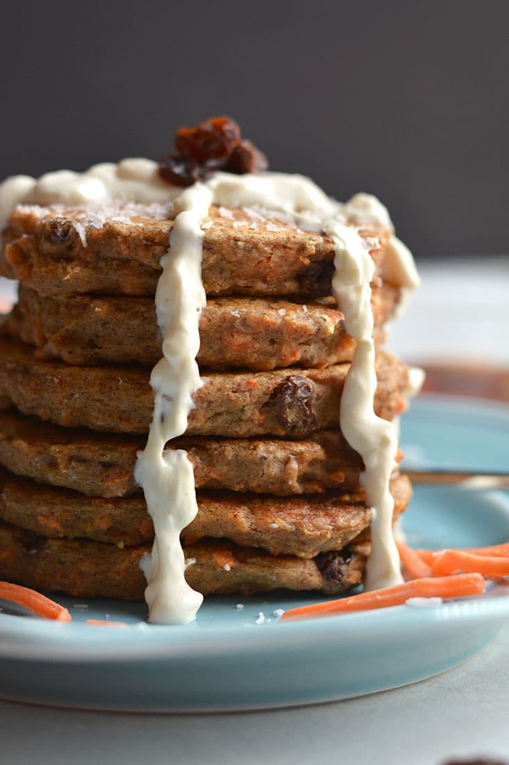Healthy Carrot Cake Pancakes! These moist, mildly spiced pancakes taste like real carrot cake only in breakfast form & better for you too! Gluten Free + Low Calorie