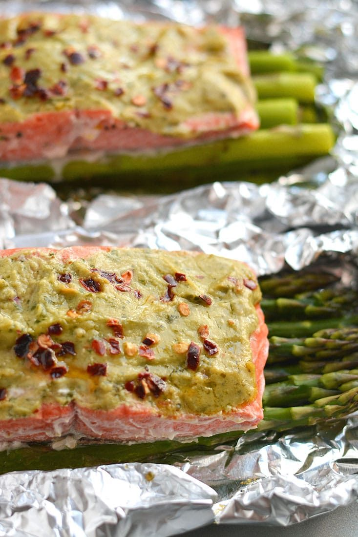 20 Minute Baked Pesto Salmon. Steamed in foil packs, this Paleo, low calorie, gluten free meal is a healthy twist on a dinner favorite! Gluten Free + Low Calorie + Paleo20 Minute Baked Pesto Salmon. Steamed in foil packs, this Paleo, low calorie, gluten free meal is a healthy twist on a dinner favorite! Gluten Free + Low Calorie + Paleo