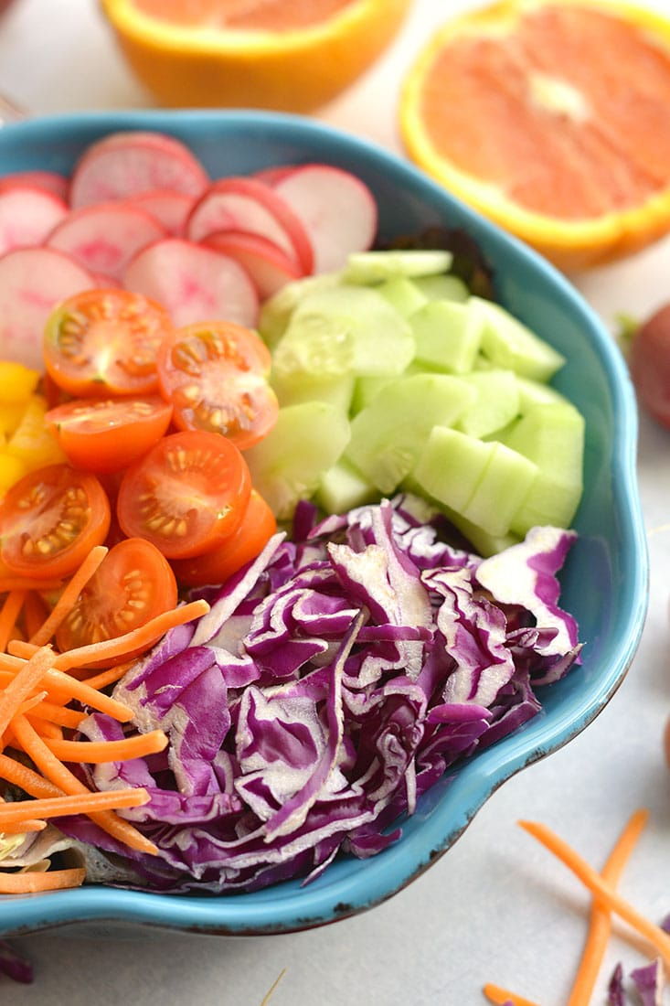 A Rainbow Detox Salad packed with fresh, healthy ingredients and a light orange dressing. Crisp cabbage, radishes, cucumber, and more! Easy to make fresh at home all in one bowl. Just toss and go! Great as a healthy vegetarian main or a side salad for any dish! Paleo + Vegan + Gluten Free + Low Calorie