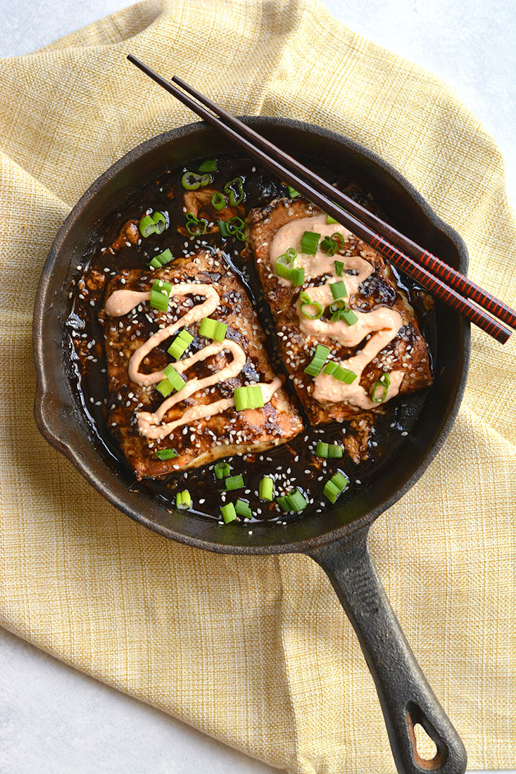 An easy skillet Teriyaki Sriracha Salmon marinated in a homemade teriyaki sauce & topped with a Sriracha Greek yogurt sauce that you can't resist! Big on flavor, spicy as you like & perfect for a quick meal. Gluten Free + Low Calorie