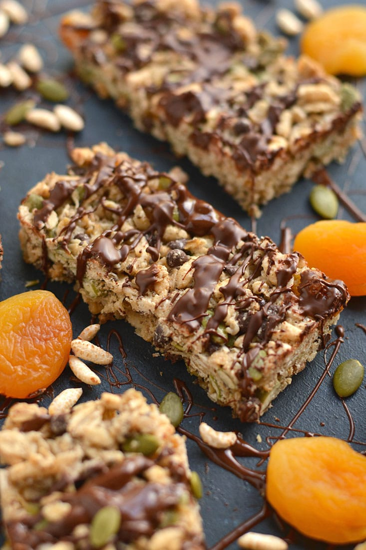 These homemade Trail Mix Granola Bars are easy to make with apricots, gluten free oats, brown rice cereal, pumpkin seeds & chocolate. A sweet, salty, chewy bar that's naturally sweetened. A wholesome recipe for a nutritious snack or breakfast to go! Gluten Free + Low Calorie + Vegan