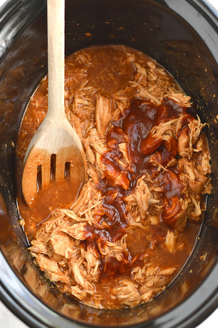 Crockpot BBQ chicken is one of the best crock pot recipes for summer picnics, potlucks, and cook-outs. Use your slow cooker to make tender, easy pulled bbq chicken, then use it for sandwiches, salads, and so much more! Pull out the bibs, keep your napkin at the ready, and grab the bbq sauce, because.